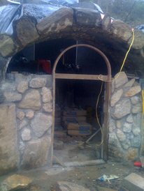 hobbit house construction formwork concrete dome masonry entrance wall